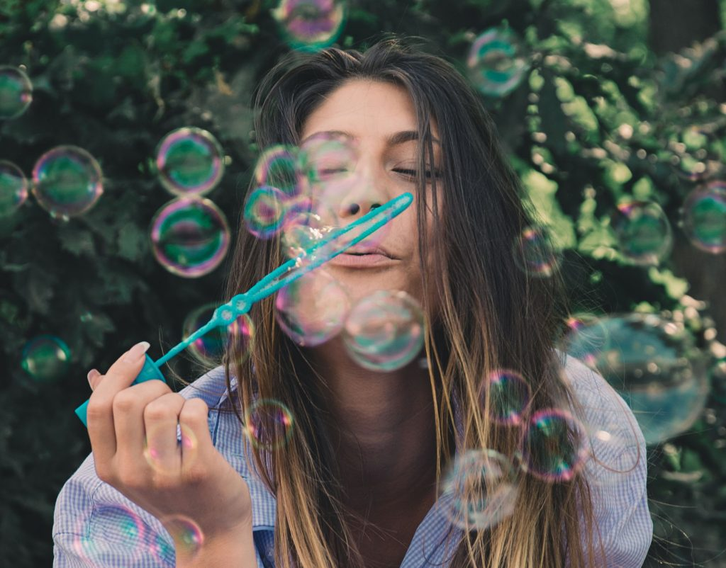 Ways to be happy today - girl blowing bubbles