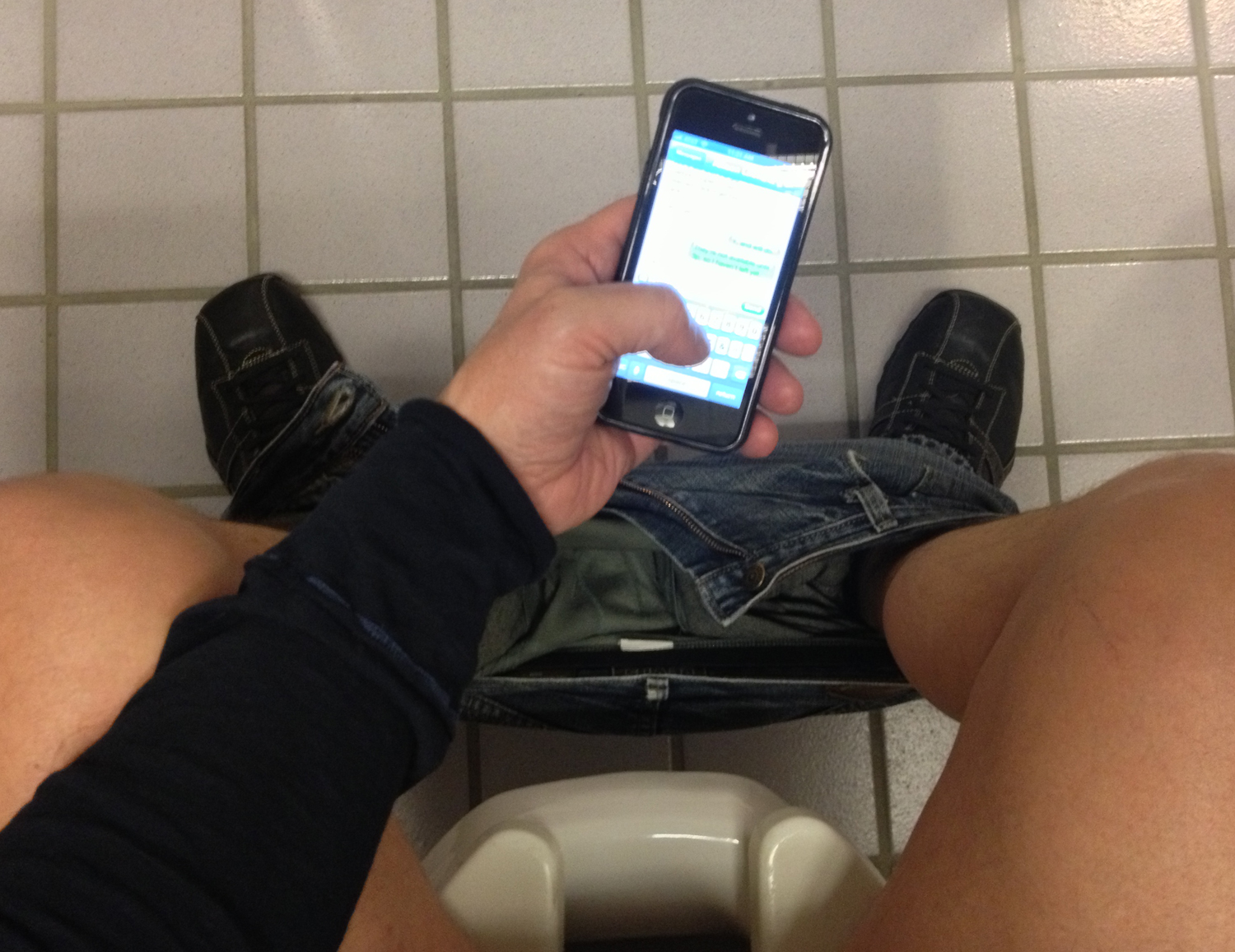 phone addiction in the bathroom