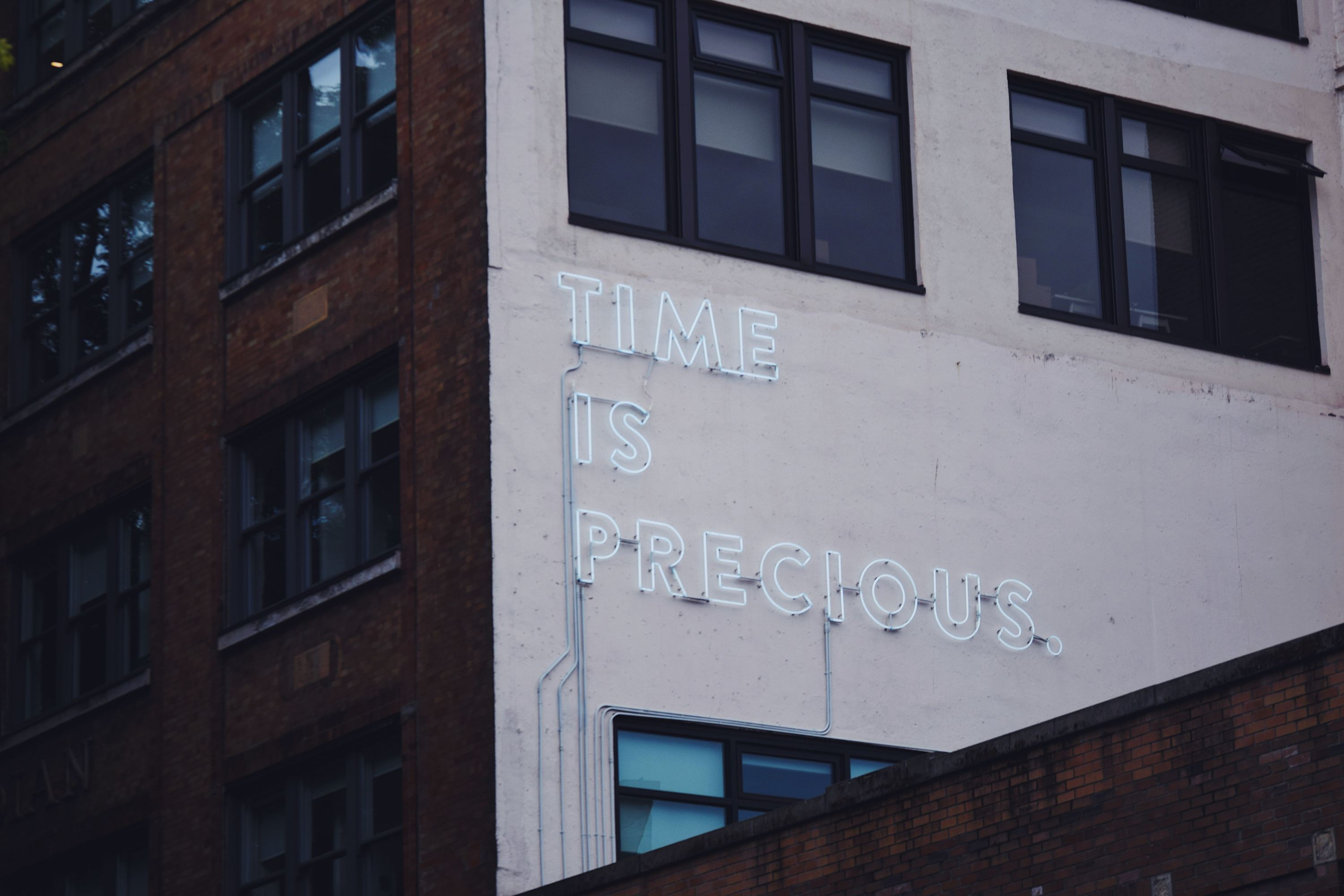 Neon sign saying 'time is precious' - the attention economy
