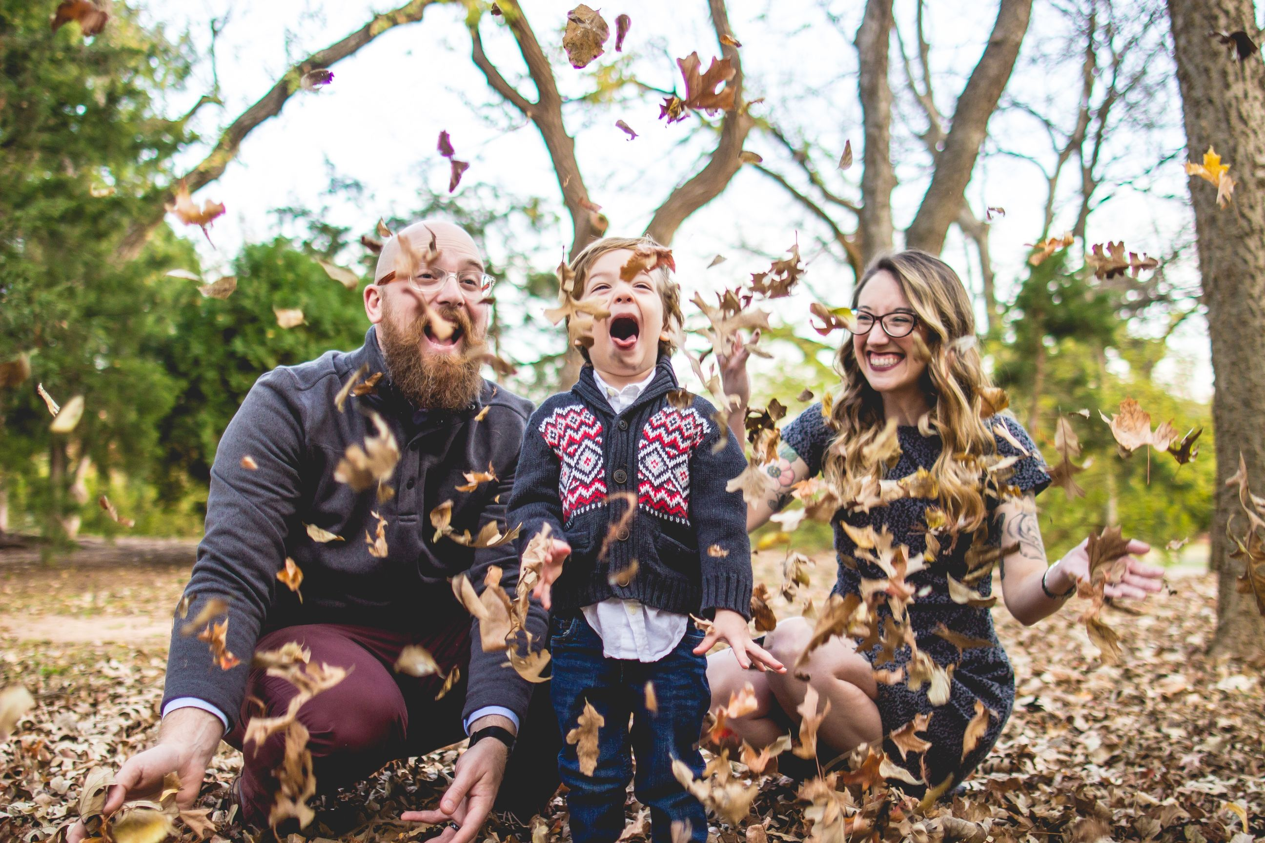 Family playing in leaves: mindful parenting