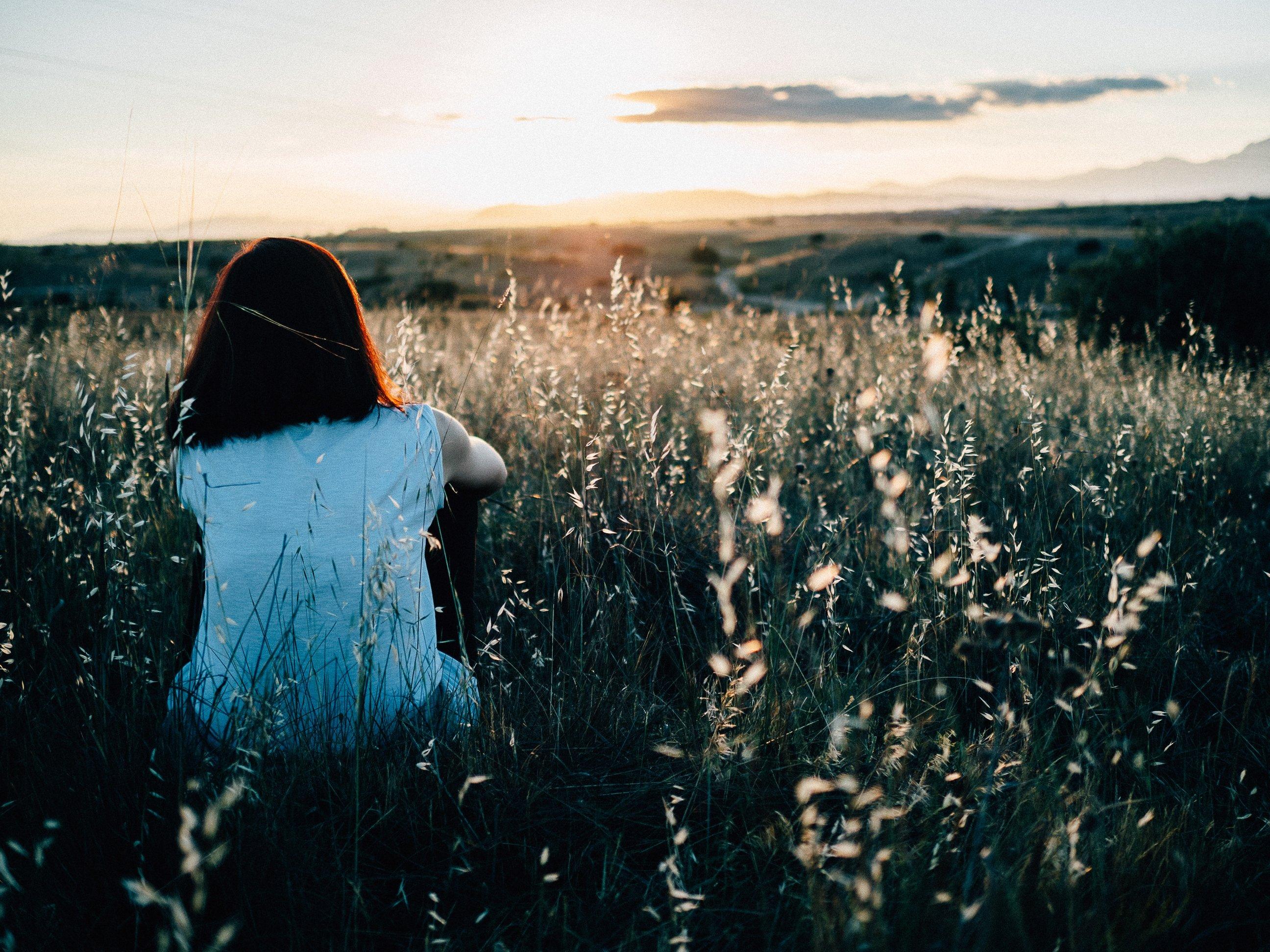 Girl watching sunset: mindfulness exercises