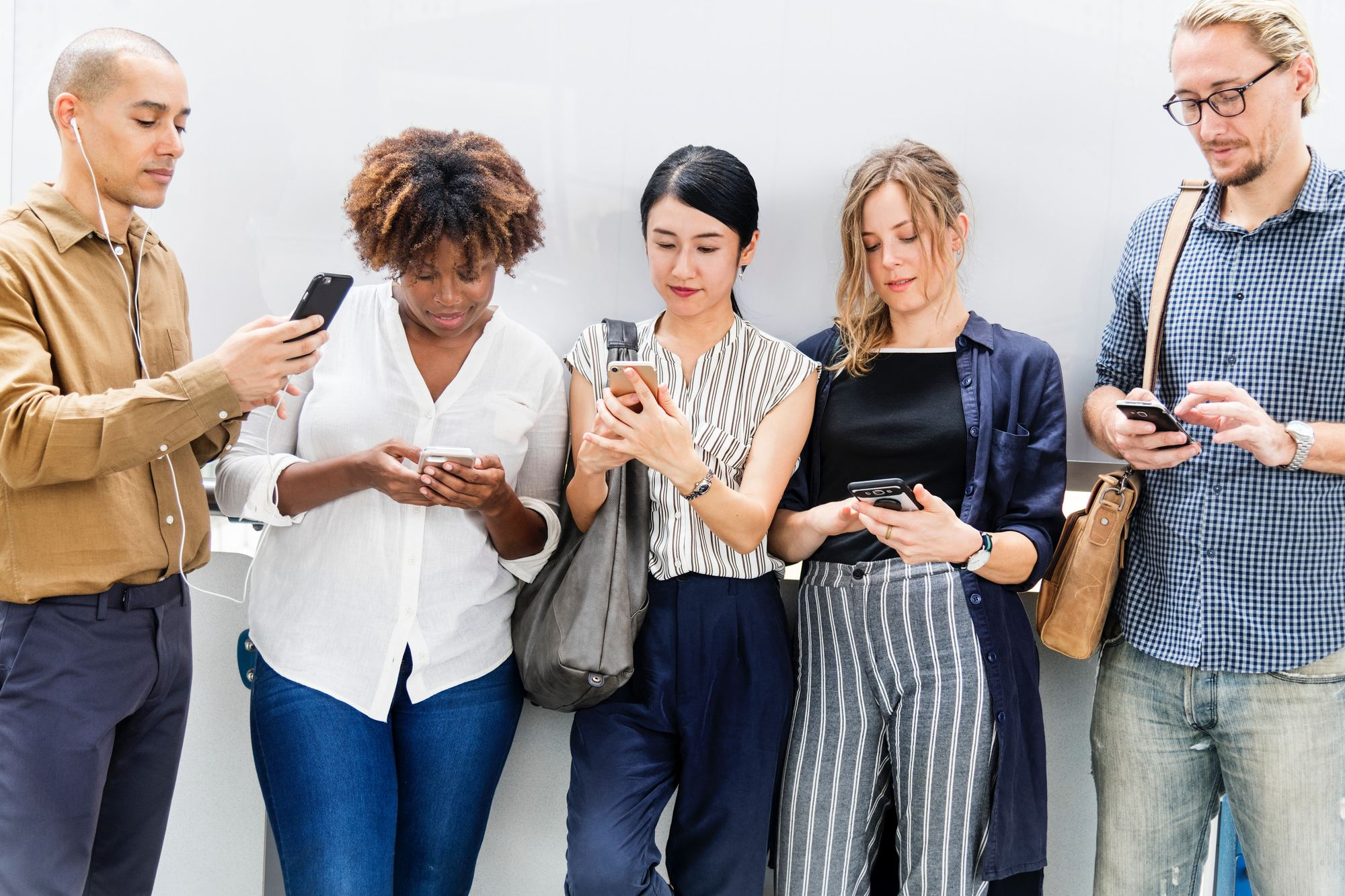Group of people scrolling on smartphones